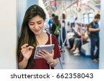 asian woman passenger with... | Shutterstock . vector #662358043