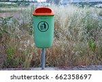 green trash bin in the park | Shutterstock . vector #662358697