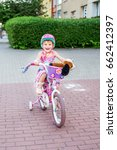 small cheerful child rides a... | Shutterstock . vector #662412397