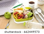 close up green lunch box on... | Shutterstock . vector #662449573