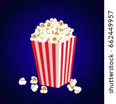 carton bowl full of popcorn and ... | Shutterstock . vector #662449957
