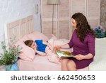 bedtime concept. mom put her... | Shutterstock . vector #662450653