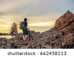 hiking  stand backpack on beach ... | Shutterstock . vector #662458213