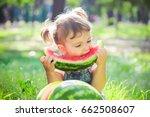 a child eats watermelon.... | Shutterstock . vector #662508607
