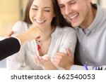 close up of a happy homeowners... | Shutterstock . vector #662540053