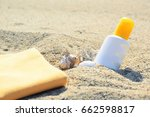 sunscreen tube on the sand next ... | Shutterstock . vector #662598817