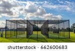 Small photo of A row of cricket practice nets on green grass and with a blue sky in Melbourne, Victoria, Australia