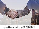 double exposure of of handshake ...   Shutterstock . vector #662609023