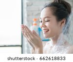 asian women are taking a shower ... | Shutterstock . vector #662618833