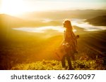 young girl meets sunrise on top ... | Shutterstock . vector #662760097