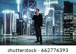 happy smiling businessman using ... | Shutterstock . vector #662776393