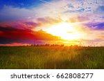 beautiful sunset over the green ... | Shutterstock . vector #662808277