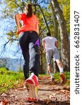 young couple jogging in park at ... | Shutterstock . vector #662831407