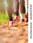 young couple jogging in park at ... | Shutterstock . vector #662832433