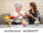senior woman and granddaughter... | Shutterstock . vector #662866597
