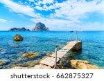 small wooden pier in cala d... | Shutterstock . vector #662875327