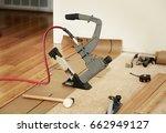 installing hard wood flooring | Shutterstock . vector #662949127