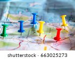 Small photo of Travel destination pin points on a map with colorful thumbtacks and depth of field with select focus.