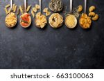 various pasta on spoons over... | Shutterstock . vector #663100063