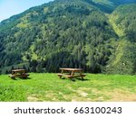 Two Wood Picnic Tables Lost In...