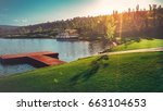 picturesque lake with a pier... | Shutterstock . vector #663104653