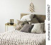 bed with wooden headboard ...   Shutterstock . vector #663108967