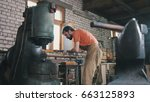 man blacksmith forges the metal ... | Shutterstock . vector #663125893