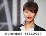 happy young woman walking in... | Shutterstock . vector #663219397