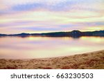 abandoned sandy beach at lake ... | Shutterstock . vector #663230503