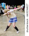 Small photo of Sheffield, UK - June 04, 2017: Cosplayer dressed as a character from the anime and manga 'Love Live' dabbing at the Yorkshire Cosplay Con at Sheffield Arena.