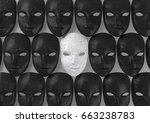 Smiling White Mask Among Black...