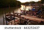 long tailed boat  at pier  | Shutterstock . vector #663252637