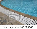 outdoor swimming pool with... | Shutterstock . vector #663273943
