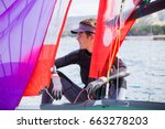 young guy drives a sailing... | Shutterstock . vector #663278203