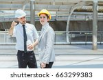 two engineer look to target at... | Shutterstock . vector #663299383