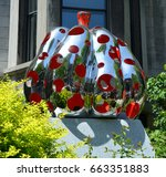 Small photo of MONTREAL QUEBEC CANADA 06 12 17: Yayoi Kusama, PUMPKIN, polished stainless steel, urethane paint, developed a distinctive style utilizing approaches associated with Abstract Expressionism