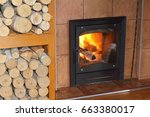 firewood burning in the stove. | Shutterstock . vector #663380017