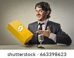 businessman showing a product | Shutterstock . vector #663398623
