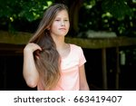 young teenage girl in the park... | Shutterstock . vector #663419407