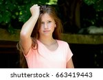 young teenage girl in the park... | Shutterstock . vector #663419443