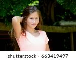 young teenage girl in the park... | Shutterstock . vector #663419497