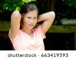 young teenage girl in the park... | Shutterstock . vector #663419593
