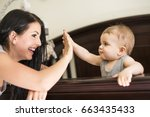 a mother putting baby to sleep... | Shutterstock . vector #663435433