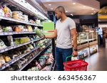 young african man buying... | Shutterstock . vector #663456367