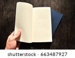 a book on a vintage wood table... | Shutterstock . vector #663487927