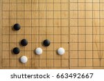 Small photo of Go, an ancient Chinese board game that contain of many possibility of the direction of the game. Many asian business man use this game to practice his mention and decision skill.