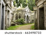 Small photo of Highgate Cemetery, Highgate, London. There are approximately 170,000 people buried in around 53,000 graves in Highgate Cemetery, notable for many of the people buried there inc. Karl Marx