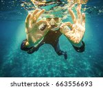 Scuba Diver Underwater Showing...