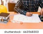 civil design engineer is making ... | Shutterstock . vector #663568303
