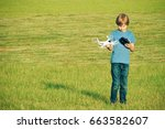 little boy playing with drone... | Shutterstock . vector #663582607